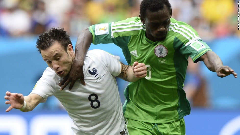 Oshaniwa fights off Valbuena during the first half.