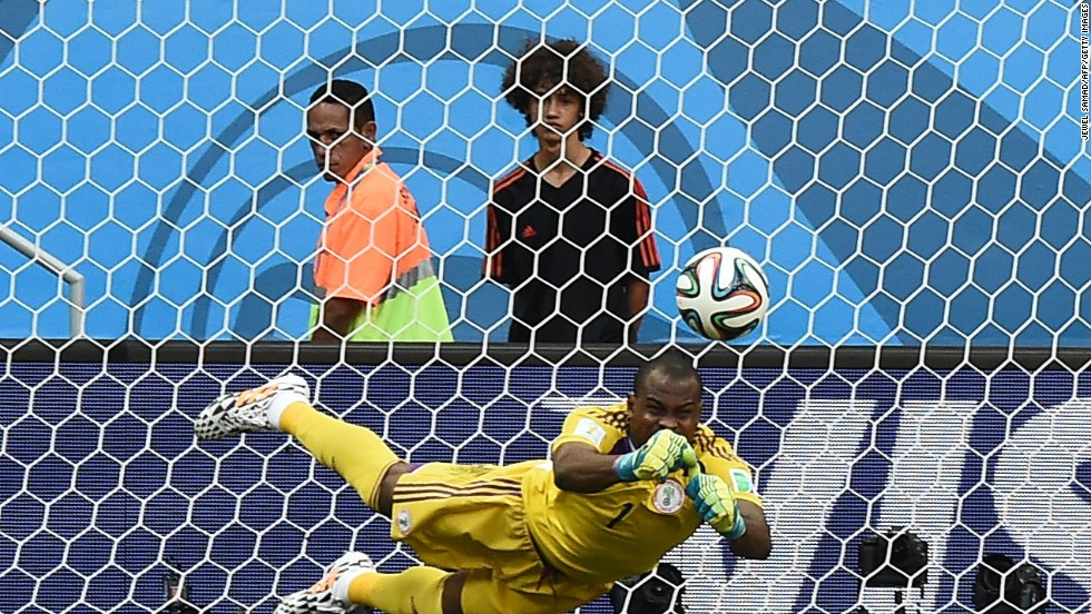 Nigeria's goalkeeper, Vincent Enyeama, punches the ball away from goal.