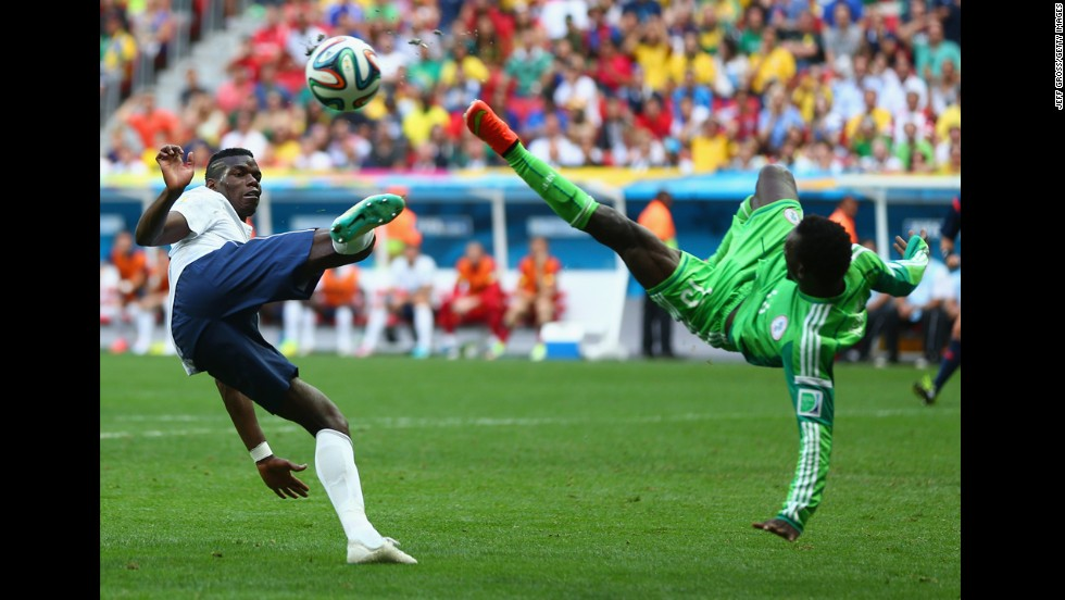 Pogba and Juwon Oshaniwa of Nigeria compete for the ball during the second half.