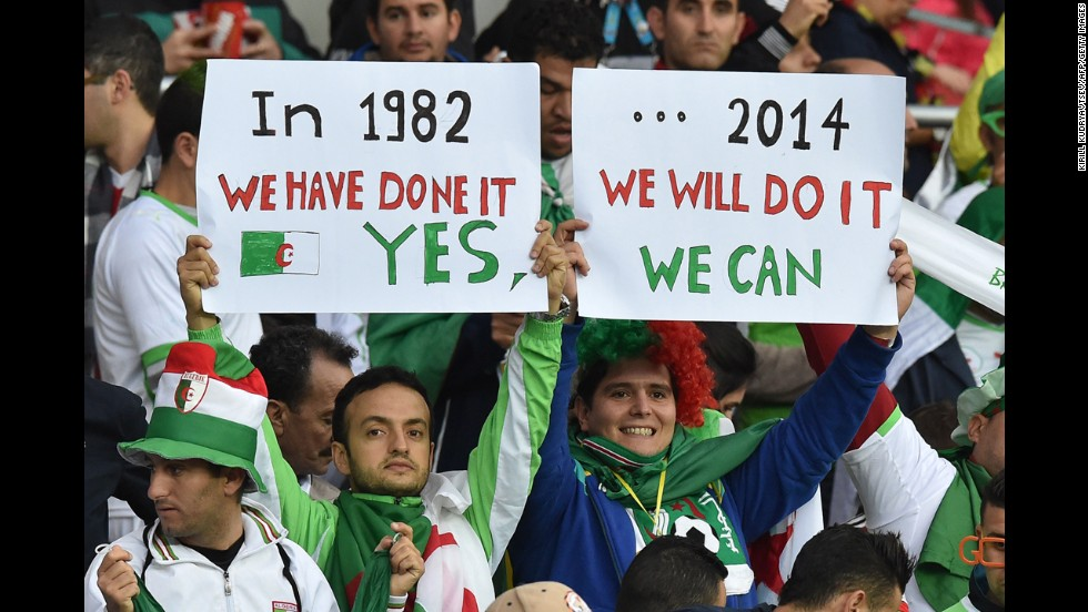 Algeria fans cheer during the match.