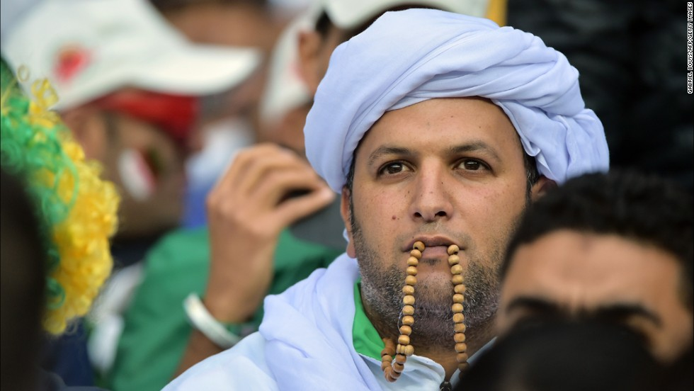 An Algeria fan awaits the kickoff of the match.