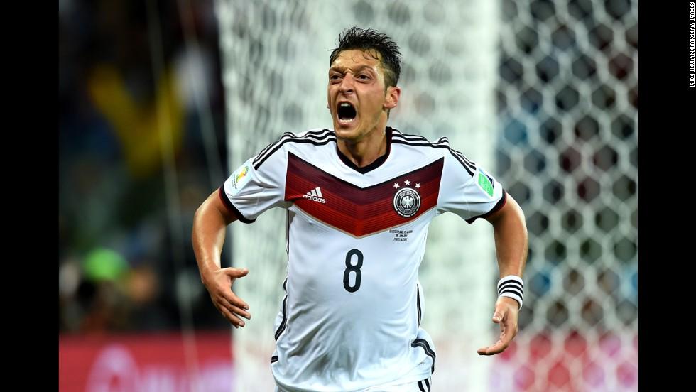 Mesut Oezil of Germany celebrates scoring his team's second goal.