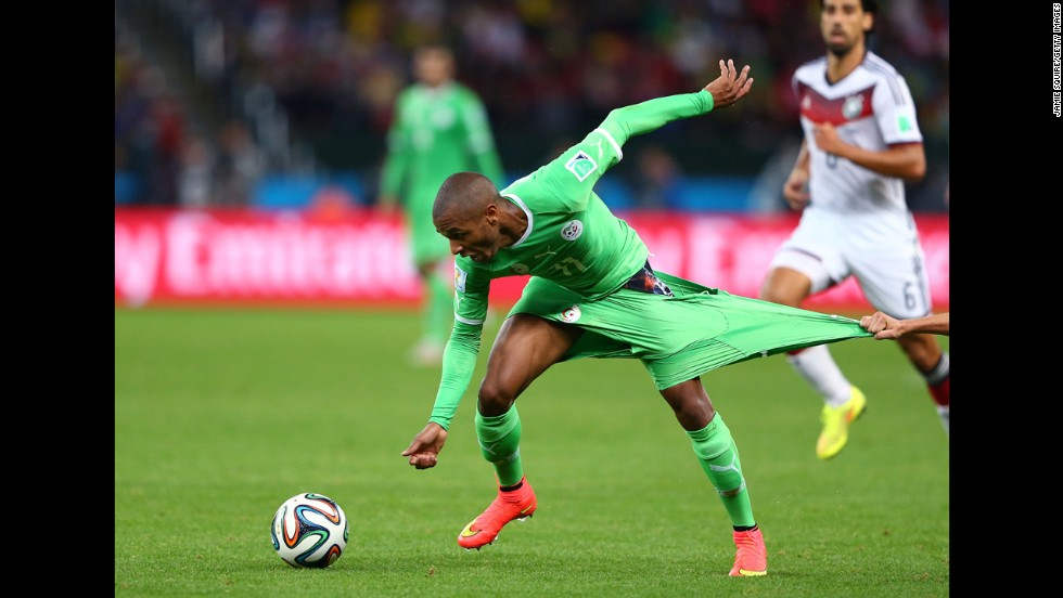 Yacine Brahimi of Algeria has his shorts pulled by Philipp Lahm of Germany during their World Cup match Monday, June 30, in Porto Alegre, Brazil. Germany advanced to the quarterfinals with a 2-1 victory.