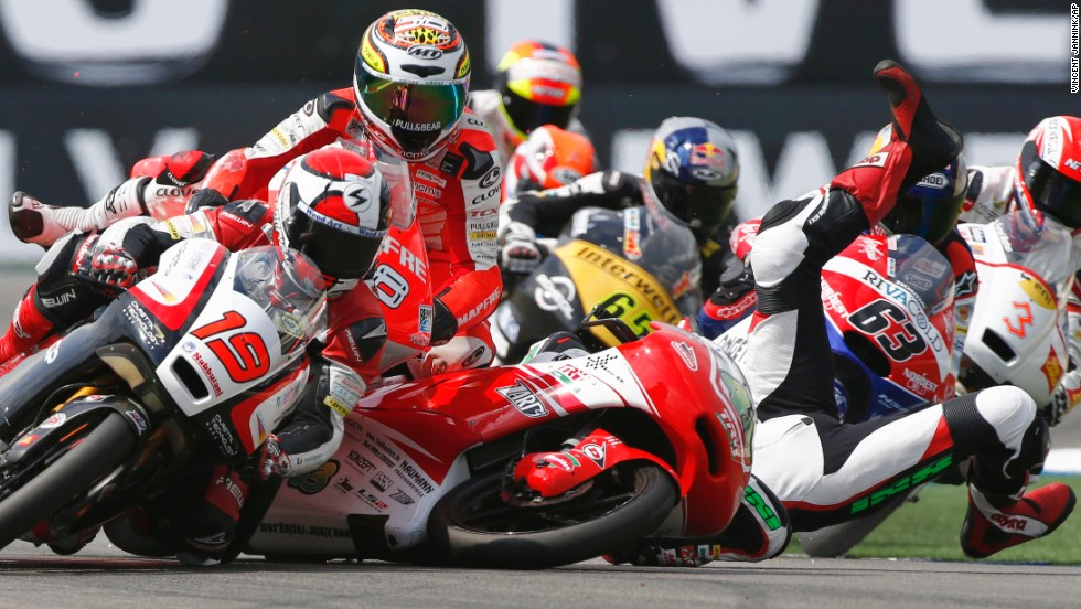 Luca Grunwald falls off his motorcycle after colliding with competitors during the final lap of a Moto3 race in Assen, Netherlands, on Saturday, June 28. He was not seriously hurt. In fact, he picked up his bike and pushed it over the finish line.
