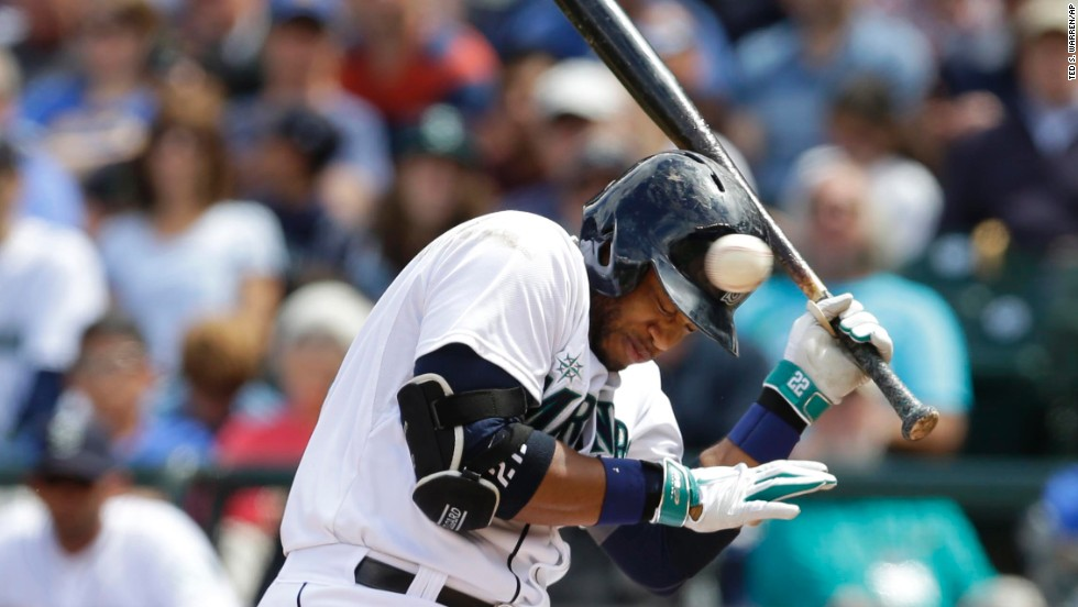 Robinson Cano of the Seattle Mariners ducks a pitch that was high and inside during a home game against Cleveland on Sunday, June 29.