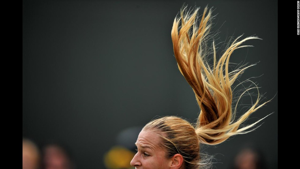 Dominika Cibulkova serves to Lucie Safarova during their third-round match at Wimbledon on Friday, June 27. Safarova won the match 6-4, 6-2.