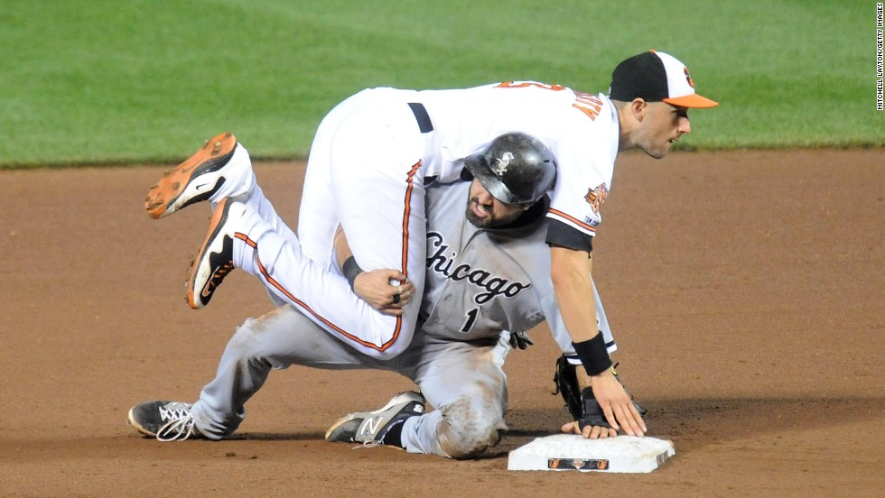 Adam Eaton of the Chicago White Sox slides under Ryan Flaherty of the Baltimore Orioles after Flaherty turned a double play in their Major League Baseball game Wednesday, June 25, in Baltimore.