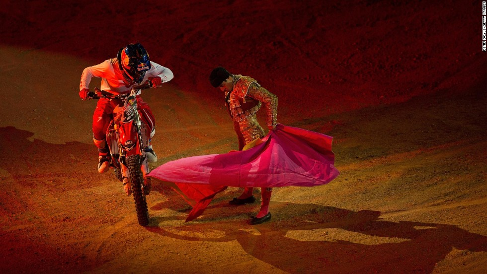 Motocross rider Josh Sheehan steers around a bullfighter at Madrid's Plaza de Toros during the Red Bull X-Fighters World Tour on Friday, June 27.