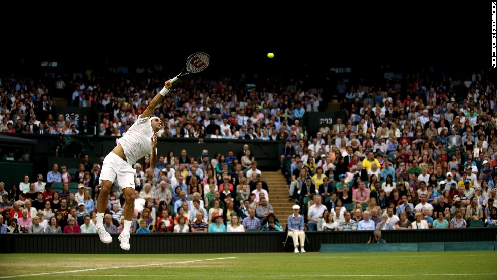 Roger Federer hits a shot during his third-round match against Santiago Giraldo at Wimbledon on Saturday, June 28. Federer, a seven-time Wimbledon champion, won the match in straight sets.