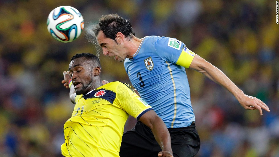 Uruguay's Diego Godin, right, and Colombia's Jackson Martinez go for a header during their World Cup round-of-16 match Saturday, June 28, in Rio de Janeiro. Colombia won 2-0 to advance to the quarterfinals.