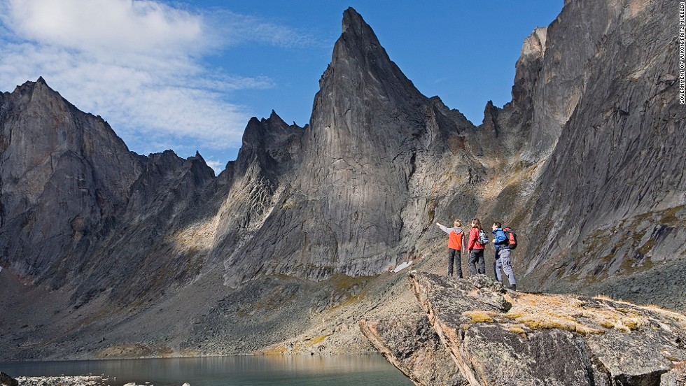 "You know when the Yukon government advises you to <a href=""http://www.env.gov.yk.ca/camping-parks/tombstonepark.php"" target=""_blank"">leave a hiking plan </a>with local police before traveling into the Tombstone Park area you're in for a wild time. This 2,200-square-kilometer (849 square miles) park, located 90 minutes from Dawson City, is filled with rugged peaks, permafrost landforms and wildlife. <a href=""http://www.env.gov.yk.ca/camping-parks/tombstonepark.php"" target=""_blank""><br />More info: Env.gov.yk.ca</a>"