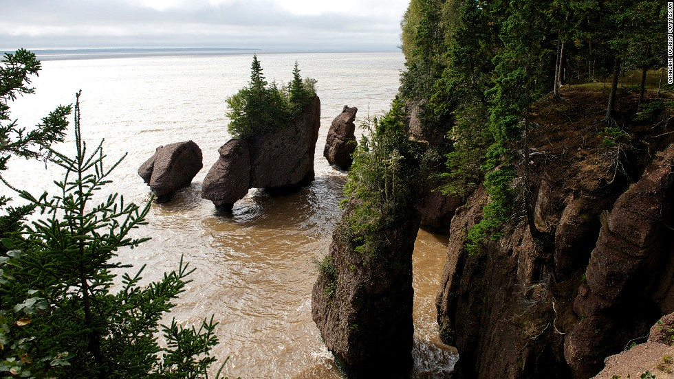 "Canada's Bay of Fundy in the Atlantic Ocean is home to the highest tides in the world. As a result, New Brunswick's incredible, eroded <a href=""http://www.thehopewellrocks.ca/"" target=""_blank"">Hopewell Rocks</a> are covered in water twice a day. The time span between low and high tide is six hours and 13 minutes, giving visitors time to stroll on the ocean floor. <a href=""http://bayoffundytourism.com/"" target=""_blank""><em><br />More info: Bayoffundytourism.com</a></em>"