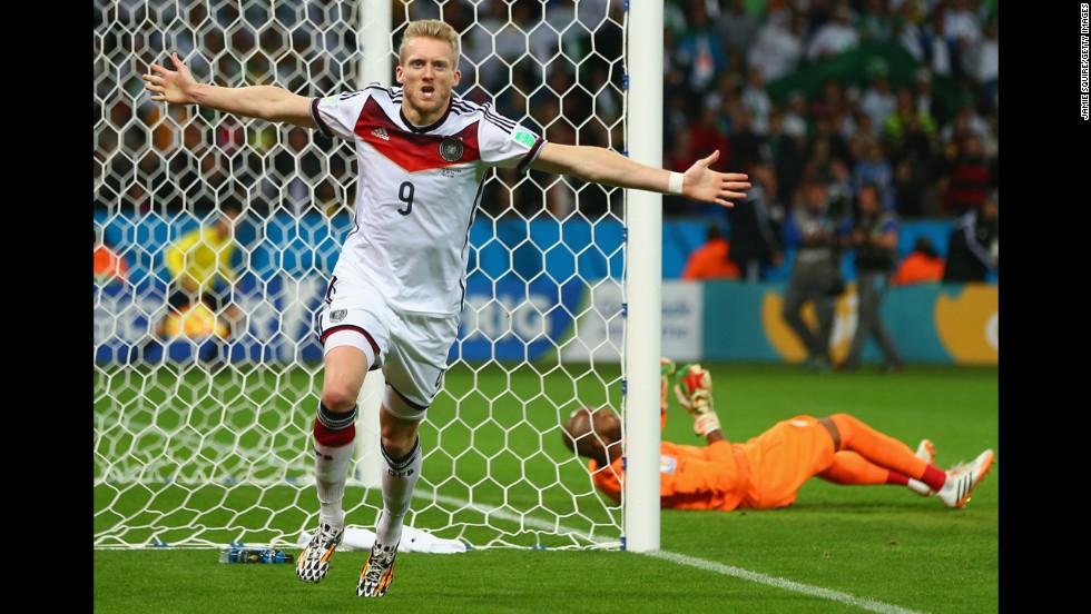 Andre Schuerrle of Germany celebrates scoring his team's first goal past goalkeeper M'Bolhi of Algeria.