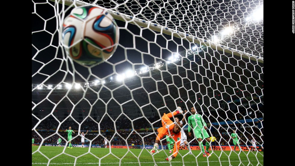 M'Bolhi of Algeria fails to save a shot by Schuerrle in extra time.