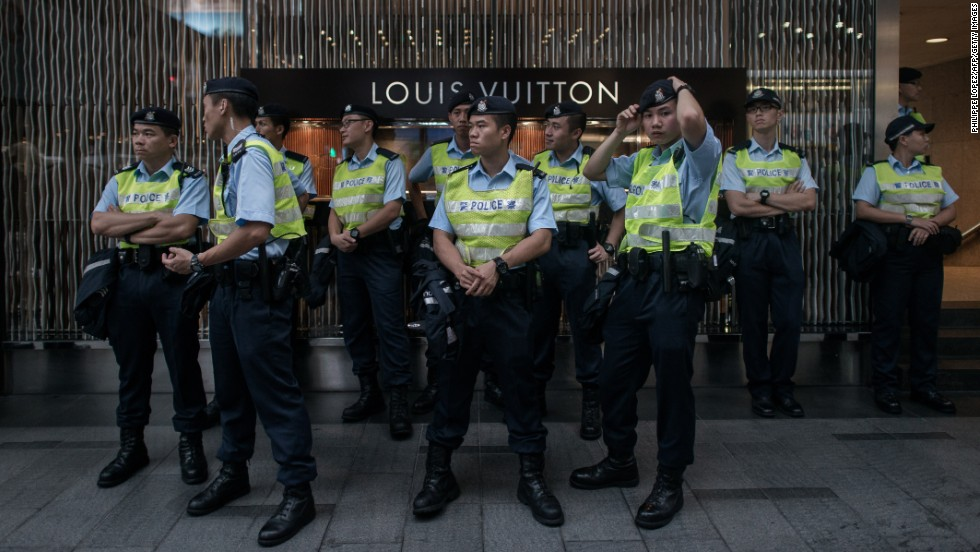 Policemen stood guard in front of a store in the Central district of Hong Kong during the rally.
