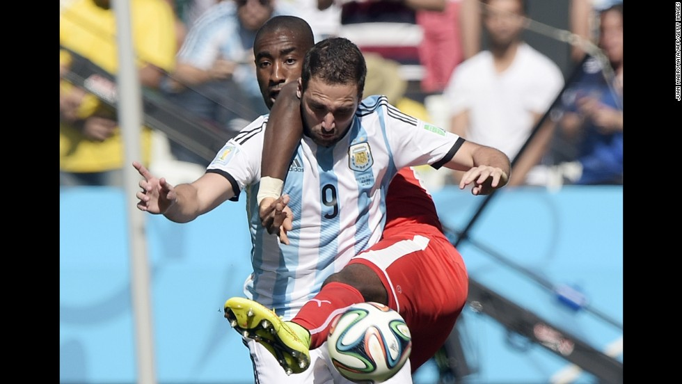 Djourou, back, and Argentine forward Gonzalo Higuain compete for the ball.