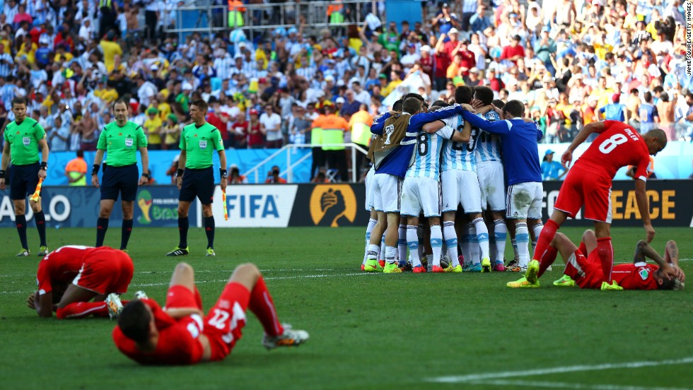 Argentina players celebrate in a huddle after they defeated Switzerland 1-0 in extra time during a World Cup round-of-16 match July 1 in Sao Paulo, Brazil.