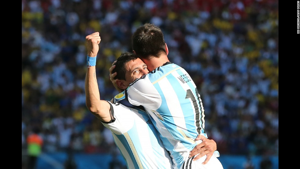 Argentina's Angel Di Maria, left, celebrates the winning goal with teammate Lionel Messi.