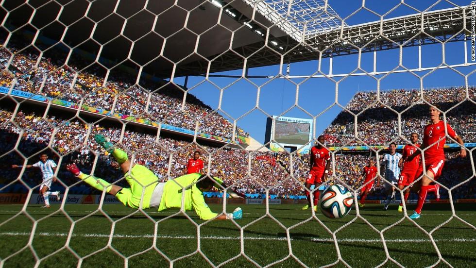 Di Maria's shot passes Swiss goalkeeper Diego Benaglio.