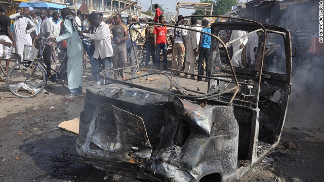 People gather at the scene of a car bomb explosion, at the central market, in Maiduguri, Nigeria on July 1, 2014.