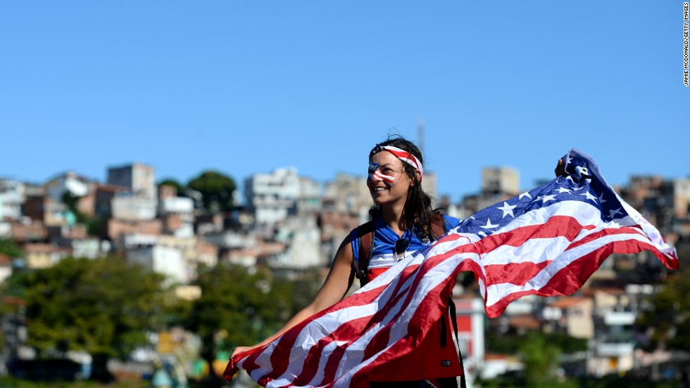 A U.S. fan in Salvador holds her flag ahead of the match on July 1.