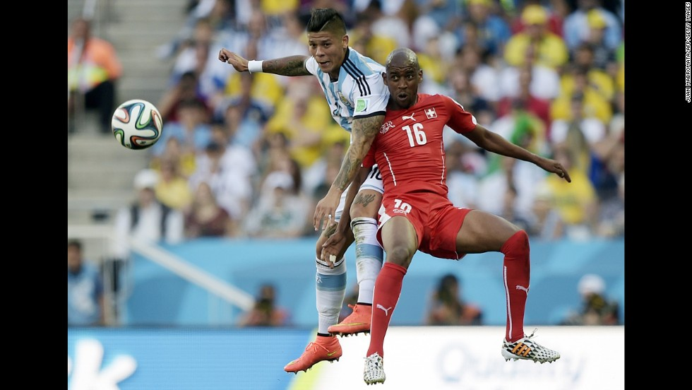 Swiss midfielder Gelson Fernandes, right, and Rojo compete for the ball.