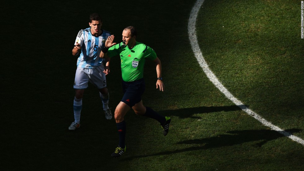 Fernando Gago of Argentina appeals to referee Jonas Eriksson.