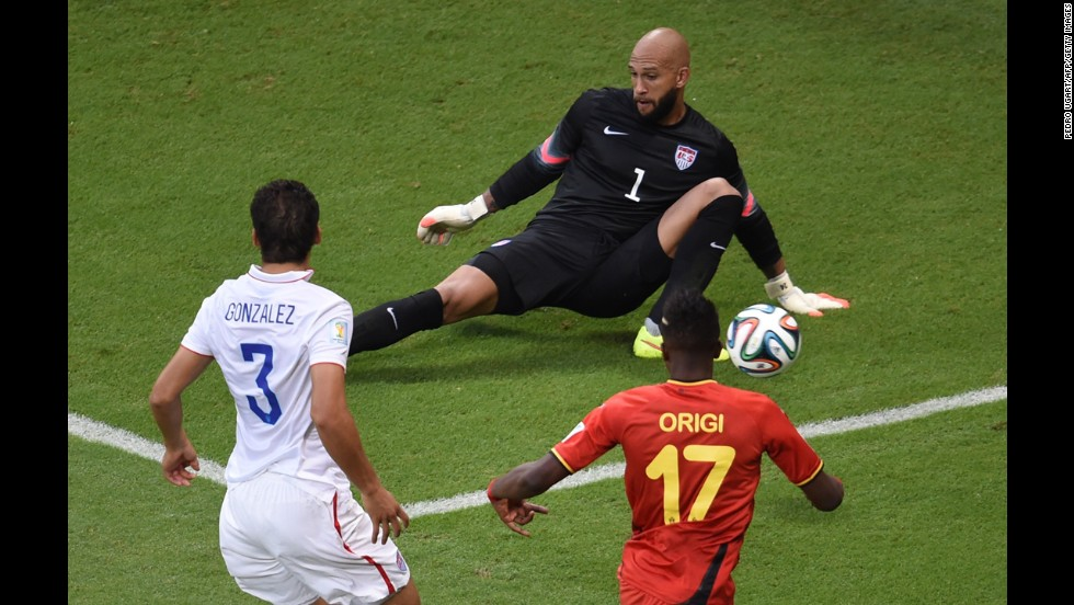 Howard makes a save on Origi in the first minute of the match.
