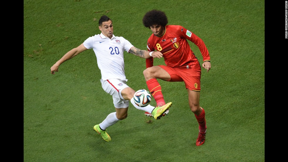 Fellaini and Cameron compete for the ball in the first half.