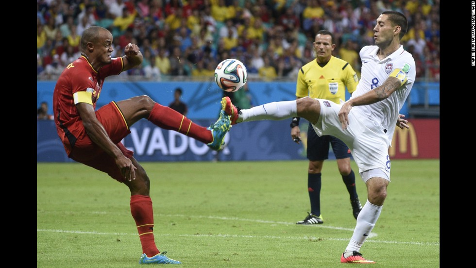 Belgian defender Vincent Kompany, left, competes with Dempsey.