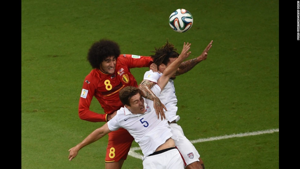 Belgian midfielder Marouane Fellaini, left, tries to win a header near Besler, center, and Jones.