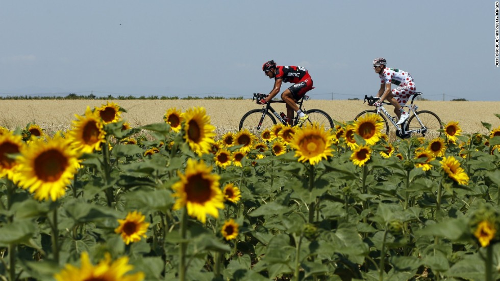 The beauty of the Tour is captured in unique images of each year's race.
