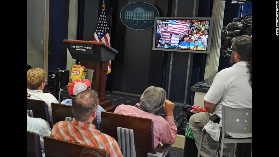 Members of the White House press corps watch the match in Washington.