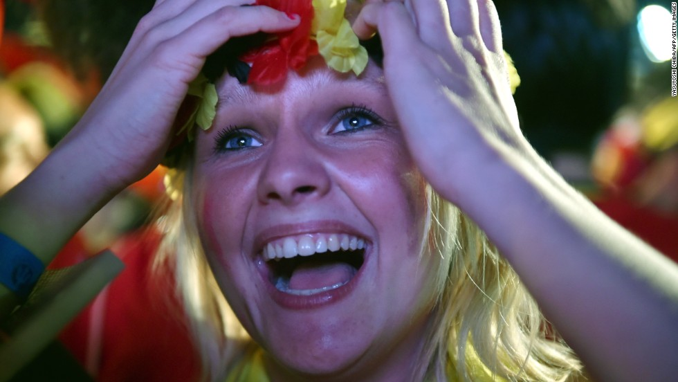 A Belgium fan reacts as she watches the round-of-16 match between Belgium and the United States from a FIFA Fan Fest viewing in Rio de Janeiro on Tuesday, July 1. Belgium won the match 2-1 in extra time.