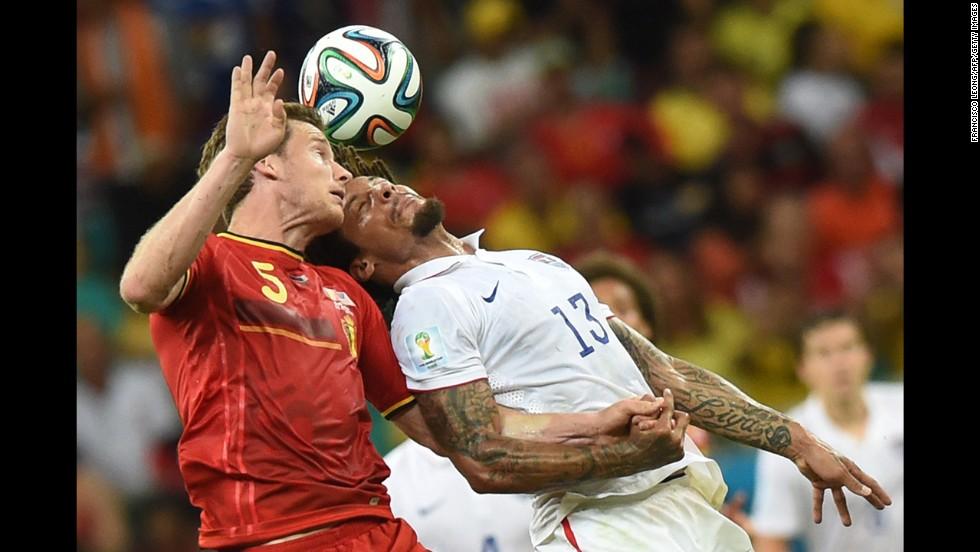 Belgian defender Jan Vertonghen, left, goes for the ball against U.S. midfielder Jermaine Jones.