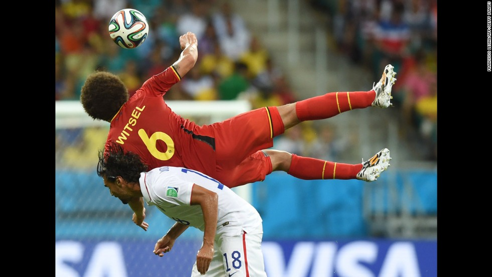 Witsel lands on Wondolowski while competing for the ball.