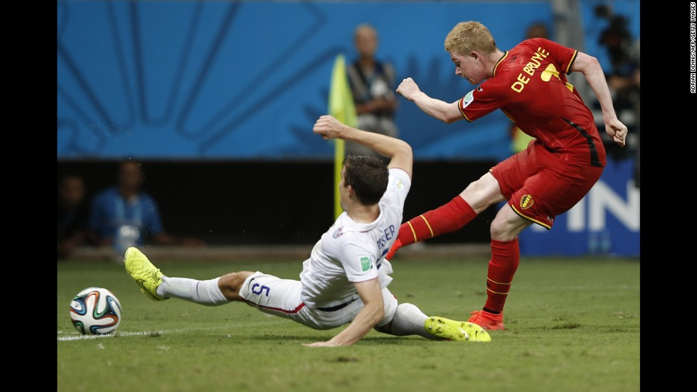 De Bruyne shoots past U.S. defender Matt Besler.