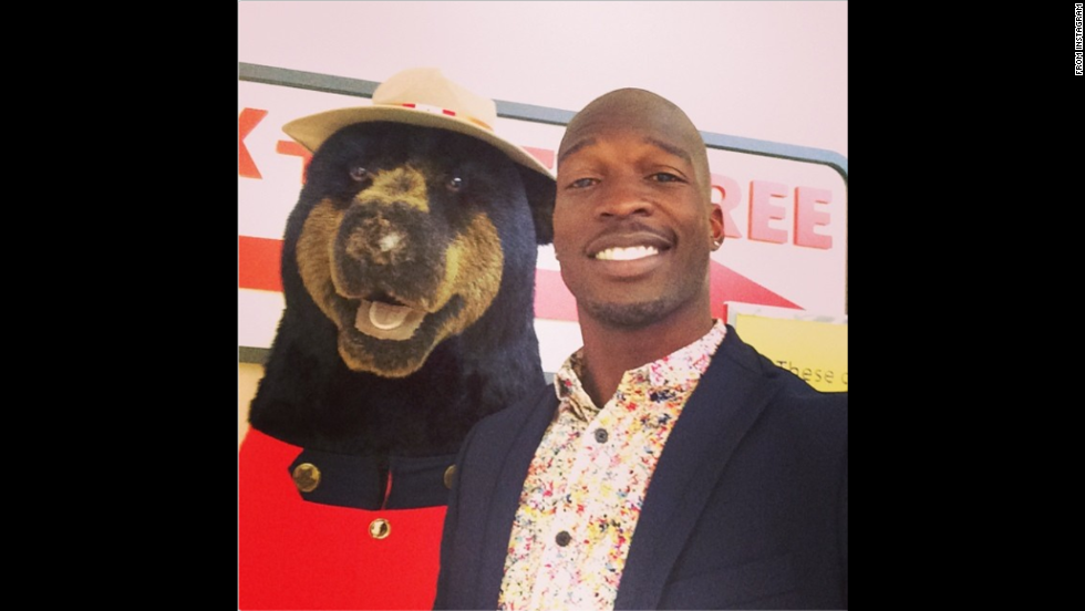 "Football player Chad Johnson takes a ""selfie with <a href=""http://instagram.com/p/p1AMwMProc/"" target=""_blank"">a cool bear wearing a Canadian uniform of some sort</a>,"" he said on Sunday, June 29. Johnson plays in the Canadian Football League now with the Montreal Alouettes."