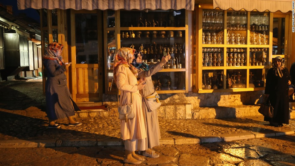 "Young women shoot a selfie while walking in the old town district of Sarajevo, Bosnia-Herzegovina, on Friday, June 27. <a href=""http://www.cnn.com/2014/06/25/world/gallery/look-at-me-0625/index.html"">See 16 selfies from last week</a>"