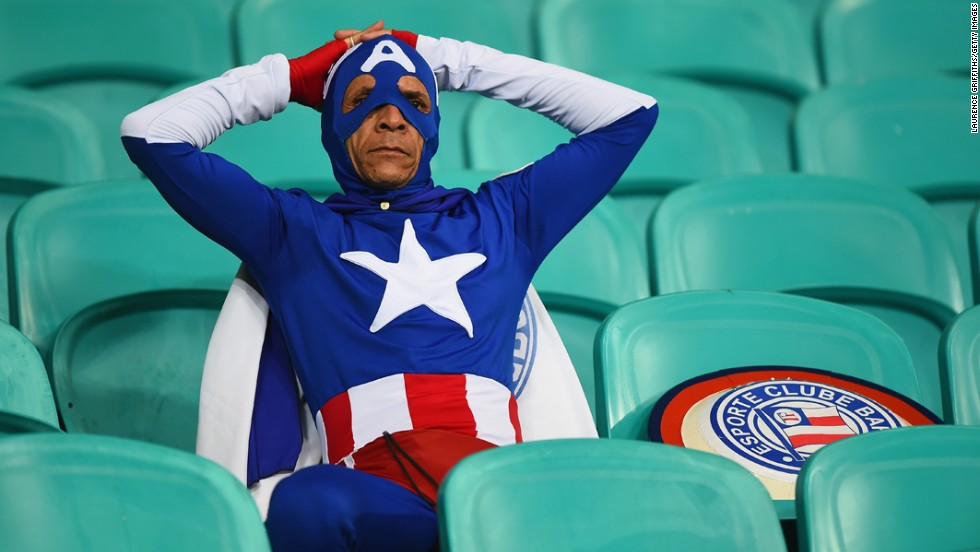 A fan dressed as Captain America looks on after Belgium's victory.