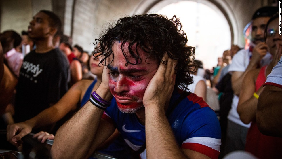 Christian Raja reacts while he and other people in New York watch the World Cup match between the United States and Belgium on Tuesday, July 1. Belgium won 2-1 to knock the United States out of the soccer tournament in Brazil.