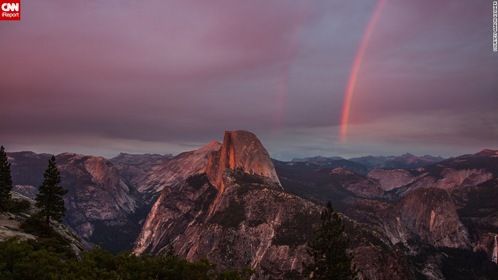 "Yosemite National Park's Glacier Point overlook is <a href=""http://ireport.cnn.com/docs/DOC-1004214"">Aaron Keigher's</a> ""favorite place in the world."" It's not hard to see why when you look at this double rainbow beside the park's iconic Half Dome."