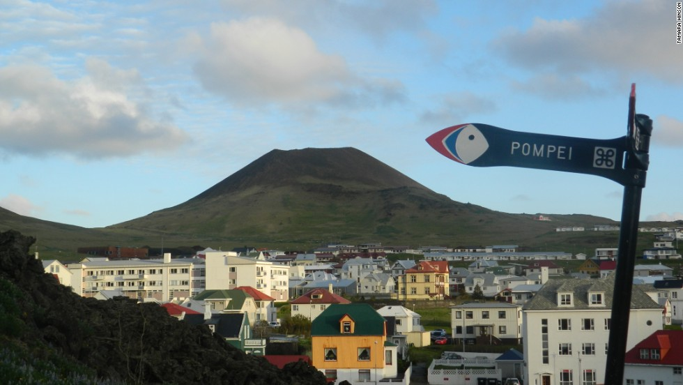 "A sign reading ""Pompei"" points the way to an area destroyed by volcanic eruption on Iceland's Heimaey Island in 1973. The eruption left one person dead and prompted the evacuation of dozens of families."