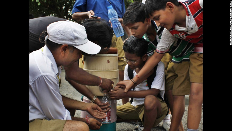 Students fight to get water in New Delhi on June 15.