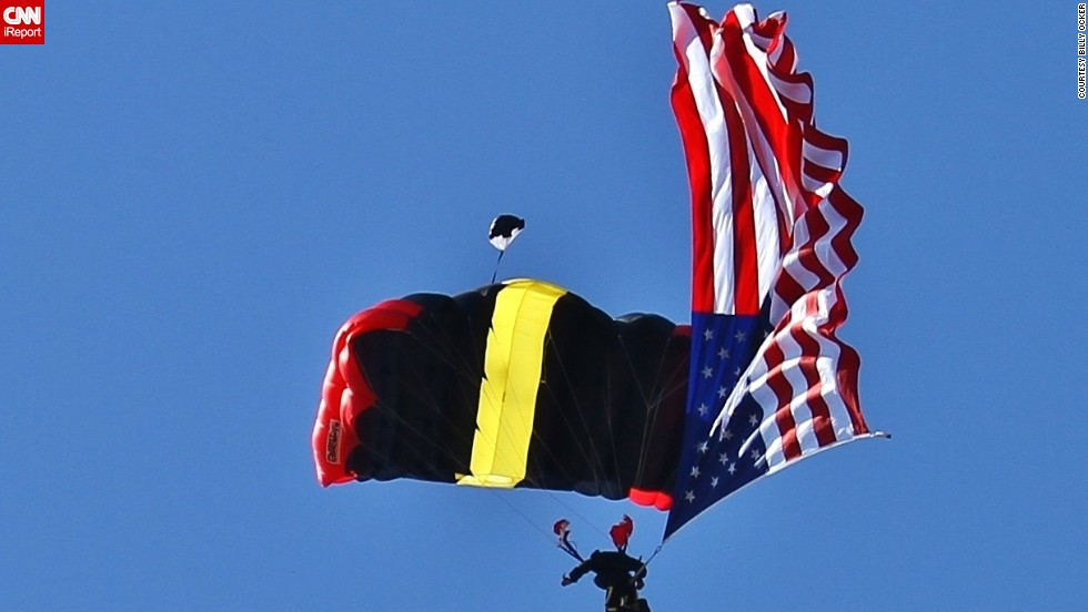 "You often see the American flag flying in the sky, but this is an over-achievement. <a href=""http://ireport.cnn.com/docs/DOC-1144092"">Billy Ocker</a> photographed the stars and stripes gliding down with a parachutist during the annual Fourth of July parade in Sebastian, Florida, in 2013."
