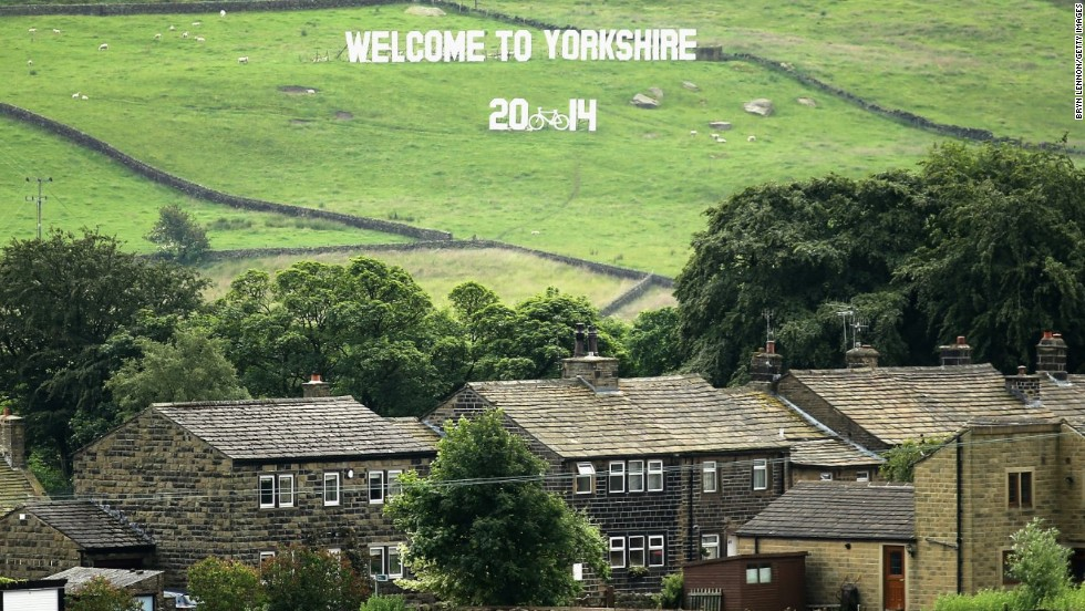 A sign welcoming the 2014 Tour de France adorns the countryside surrounding the Yorkshire village of Haworth where the famous literary Bronte sisters lived.
