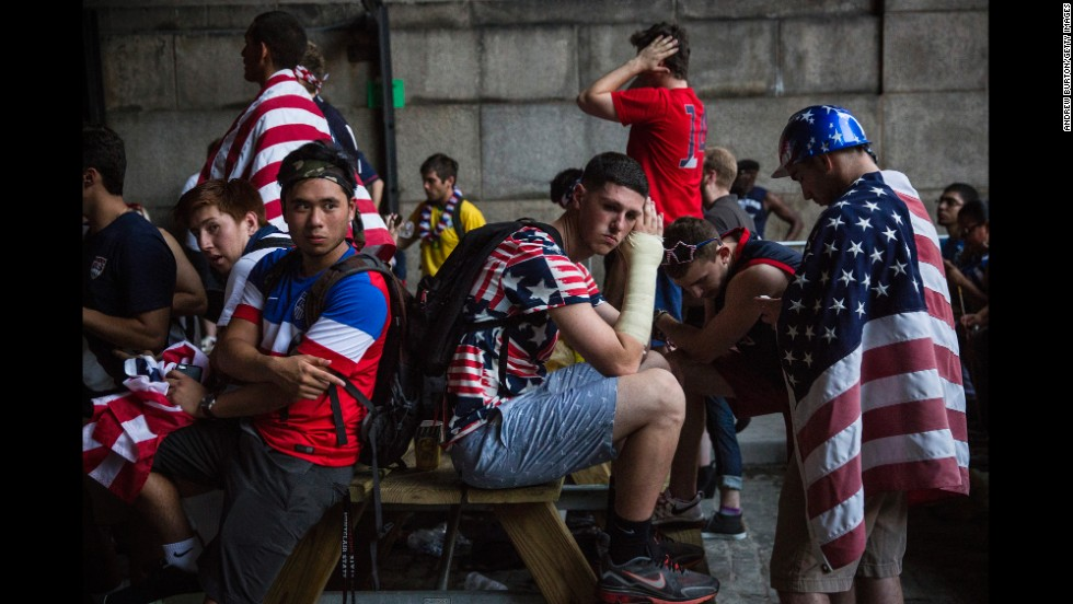 "Fans of the United States men's soccer team sit under the Manhattan Bridge in New York after the team was knocked out of the World Cup on Tuesday, July 1. The United States <a href=""http://www.cnn.com/2014/07/01/football/gallery/world-cup-0701/index.html"">lost 2-1 to Belgium</a> in a round-of-16 match played in Salvador, Brazil."
