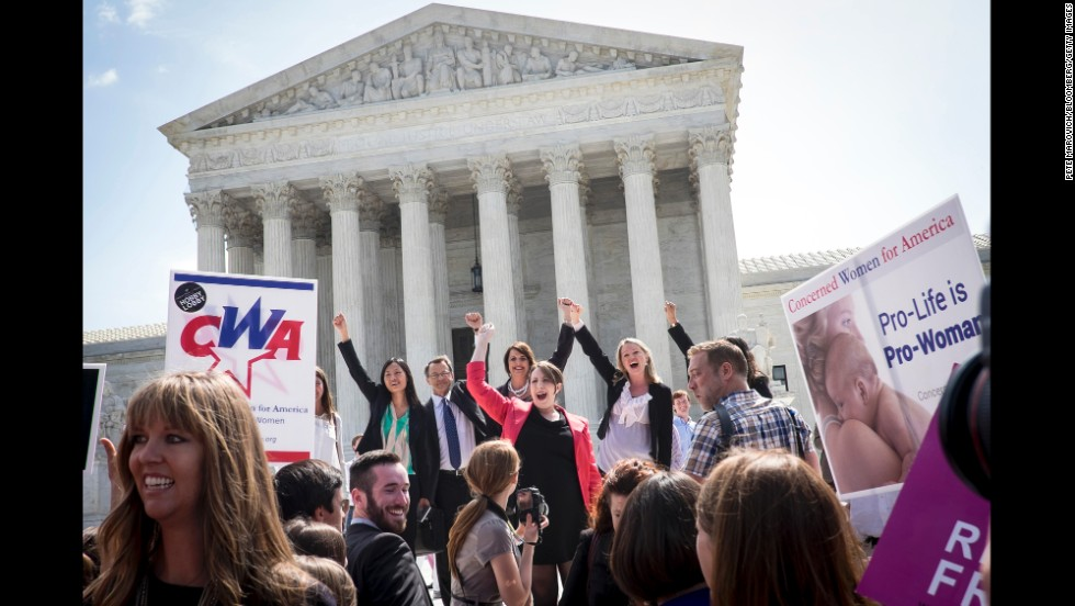 "The legal team representing craft-store chain Hobby Lobby celebrates on the steps of the U.S. Supreme Court on Monday, June 30, after <a href=""http://money.cnn.com/2014/07/01/smallbusiness/hobby-lobby-small-biz/"">the court ruled</a> that some businesses can be granted religious exemptions from certain contraceptive coverage that is required under the Affordable Care Act. Owners of Hobby Lobby and another company argued that the mandate forced them to violate deeply held religious principles. They believe some contraceptives amount to abortion."