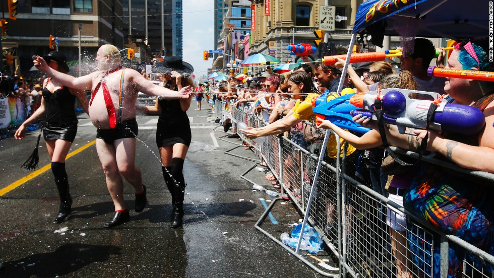 During a parade in Toronto on Sunday, June 29, people spray water guns at a man dressed to mock Toronto Mayor Rob Ford. The city was hosting WorldPride, a weeklong event celebrating the lesbian, gay, bisexual and transgender community.