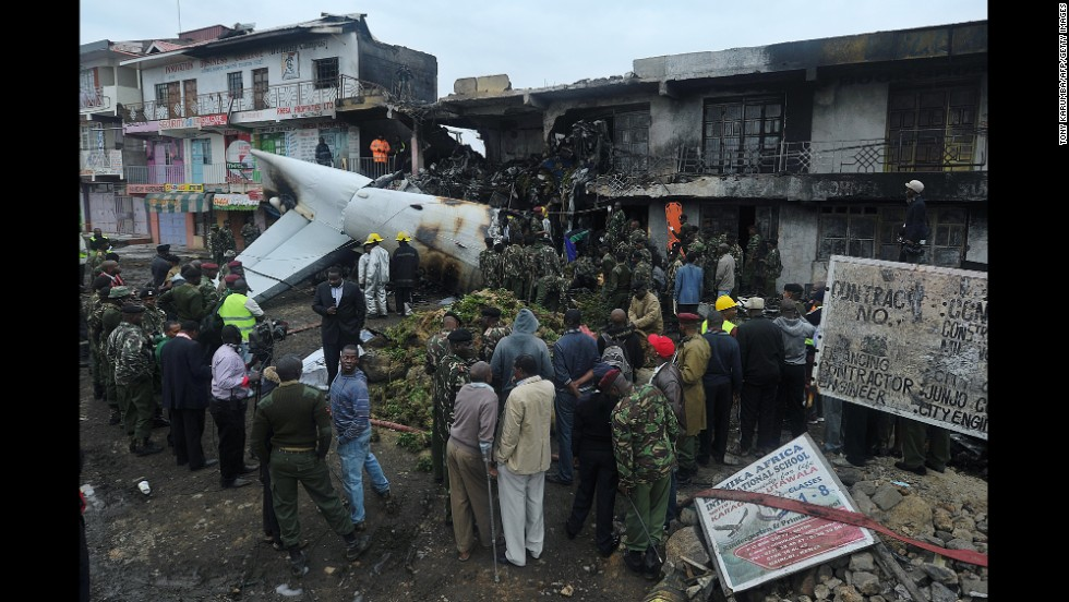 "People look at the wreckage of a cargo plane that <a href=""http://www.cnn.com/2014/07/02/world/africa/kenya-plane-crash/index.html"">crashed into a commercial building</a> Wednesday, July 2, shortly after takeoff from an airport in Nairobi, Kenya. There were four people aboard the plane. No one was inside the building at the time."